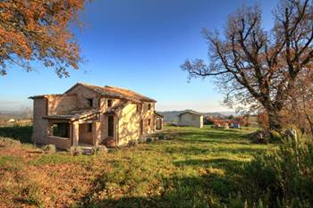 Charming stone house with amazing view over Piticchio for sale.