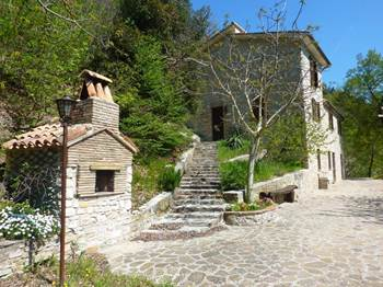 For sale Stone farmhouse within the woods in le Marche.